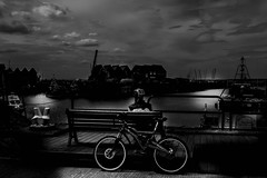 Whitstable Harbour (Jonathan Vowles) Tags: blackandwhite whitstable harbour sea night moon mono reflection kent thanet seaside quay quayside bike man moonlight