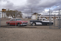 The Prison For Luxury Cars (Curtis Gregory Perry) Tags: california old classic abandoned 1955 car sedan fence hotel nikon parking lot chain link imperial clipper packard amboy d800e