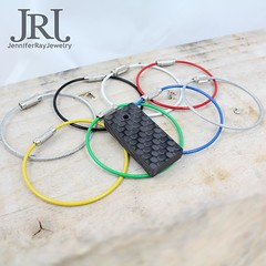 """Solid carbon fiber keychain measuring in at about 1 1/2"""" long x 3/4"""" wide x 1/4"""" thick roughly 40 mm long x 20 mm wide x 7 mm thick with one side shiny and the other matte. your choice of stainless steel keyring in: Plain, Black, White, Red, Yellow, Green (JenniferRay.com) Tags: ray jennifer jewelry carbon custom fiber exclusive paracord jrj instagram"""