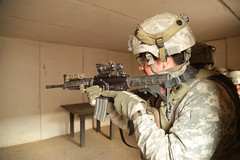 A U.S. Army Soldier assigned to 4th Battalion, 23rd Infantry Regiment, 2nd Brigade Combat Team, 2nd Infantry Division, clears a room during Decisive Action Rotation 16-03 at Fort Irwin, Calif., Jan. 28, 2016. (U.S. Army Photo by Spc. Austin Riel, Operatio (Operations Group, National Training Center) Tags: california usa ntc fortirwin 2ndinfantrydivision 23rdinfantryregiment 2ndbrigadecombatteam 4thbattalion majovedesert spcaustinmriel
