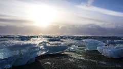 Fire and Ice (lunaryuna) Tags: winter sea sky nature beauty clouds sunrise season coast iceland colours ngc shoreline elements icefloes lunaryuna jokulsarlon glacierbay southiceland iceandfire glacialice blackvolcanicbeach thecoloursofcold seasonalwonders