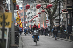 Markthof (nl.djowie) Tags: china new city boy red food netherlands colors girl bike festival hall traffic bokeh famous year den chinese performance dragons hague nieuwjaar haag chinees markthof