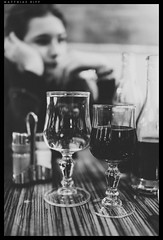 Bored (mripp) Tags: white black art girl out mono restaurant wine eating kunst sony bored going boring full alcohol frame feeling monochrom wein psychology gefhle rx1rii