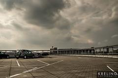 (PGKreling) Tags: street city sky clouds dark grey cityscape arnhem streetphotography dramatic approved desaturated drama streetshot hollandnederland