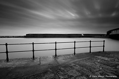 (Claire Hutton) Tags: uk longexposure winter sea england blackandwhite bw white motion black water monochrome misty clouds contrast fence mono movement flat extreme smooth overcast wideangle spray coastal le dorset rails cobb milky railings 48 silky westcountry dense ndfilter jurassiccoast neutraldensity firecrest ndgrad leefilters 16stops formatthitech sonya6000 ymeregis samyang12mm 16stopper