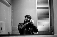 [il maniaco dei bagni] a Varese (Urca) Tags: blackandwhite bw selfportrait analog self 35mm nikon bn autoritratto varese biancoenero nikonfe2 2015 analogico ilmaniacodeibagni nikonfe201603220017