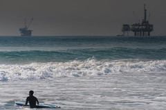 Let the sea catch your grace (.KiLTRo.) Tags: california sea beach water surf unitedstates surfer surfing rider huntingtonbeach surfspot oilfields kiltro