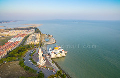 shoreline development from arial view (sydeen) Tags: ocean travel blue sea sky building tourism water beautiful architecture landscape religious design worship asia view state background magic muslim islam traditional famous faith religion shoreline landmark mosque east malaysia masjid malacca islamic arial