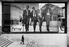 Walking down stairs in Liverpool (dandi723) Tags: street city uk travel england people blackandwhite bw woman monochrome architecture stairs liverpool canon shopping eos photo store border grain beatles efs 1022mm hmv d550