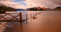 Derwentwater (Andy Watson1) Tags: park uk trip travel blue light vacation england sky cloud lake holiday snow mountains reflection english rock clouds canon fence landscape island march countryside boat spring scenery long exposure view britain district jetty united great smooth lakedistrict scenic sigma kingdom snowcapped national shore cumbria derwentwater steamer keswick catbells borrowdale 70d