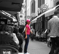 Attraction in Den Bosch (STEHOUWER AND RECIO) Tags: street pink people woman holland netherlands girl beautiful dutch lady photo pretty nederland waitress dame denbosch vrouw colouring grolsch meisje attraction prettyinpink shertogenbosch selective straat