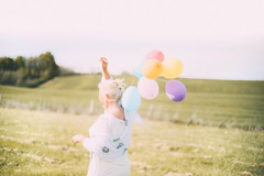 Happiness. (Amlie Roy) Tags: life portrait woman sun white france love nature beauty lady balloons fun gold countryside spring movement colorful dof wind pastel air joy balloon happiness cheerful joyful springtime makeportraits whiteaddict