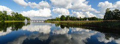 bridge to clouds (Mris Pehlaks) Tags: bridge blue autumn trees sky white lake reflection green nature architecture clouds landscape town outdoor latvia final aluksne