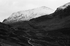 (Lee Fryer) Tags: travel winter wild bw white snow black west film 35mm landscape scotland highlands long exposure grain scottish places olympus glen wanderlust adventure explore highland wilderness tones ilford fp4 coe om1n