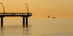 In The Golden Glow (maureen.elliott) Tags: lake water burlington pier boat dock ship earlymorning lakeontario goldenglow brantstreetpier