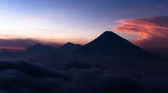 Volcanoes at Sunset (mlhell) Tags: sunset mountains night clouds landscape volcano lava guatemala eruption aguavolcano acatenangovolcano fuegovolcano