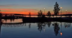 After sunset (L.Lahtinen) Tags: bridge light sunset summer sky lake nature water clouds reflections suomi finland landscape evening maisema ilta kes luonto y aftersunset jrvi auringonlasku nikond3200 silta taivas vesijrvi heijastukset sunsetonthelake jrvimaisema