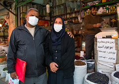 a couple wearing face masks to protect from h1n1 influenza in ganjali bazaar, Central County, Kerman, Iran (Eric Lafforgue) Tags: street people black shop horizontal outdoors photography persian couple asia day iran market traditional spice citylife stall persia streetscene business health covered pollution environment marketplace iranian bazaar dailylife typical orient sell product trade protection environmentalism economy 2people twopeople influenza bazar kerman adultsonly protect middleeastern facemask precaution spicebazaar middleagedman chador h1n1    iro  ganjalikhan centralcounty colourpicture ganjalikhancomplex  irandsc07308