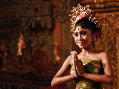 A Night at the Jegog, Ubud. (Triple_B_Photography) Tags: world travel vacation portrait people bali holiday flower colour texture film tourism beautiful closeup female contrast photoshop canon indonesia asian temple dance clothing eyes hands flora asia pretty paradise view zoom expression edited traditional prayer religion grain young culture warmth lifestyle style dancer tourist journey zen elements 7d tropical mystical local noise venue hindu hinduism pura orang cultural edit ubud blending offerings balinese lokal cantik headress puradalem jepun jegog