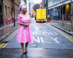 Street portrait (Street matt) Tags: street pink portrait woman color colour beautiful smile lady colorful dress head african vibrant streetphotography streetportrait wrap unusual colourful stylish individual headwrap africanheadwrap streetmatt