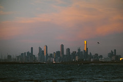 Melbourne CBD from Brighton Beach (gazrad) Tags: city sky cloud colour tower beach water horizontal skyline dawn office brighton dusk melbourne nobody landmark victoria highrise cbd grainy eureka wsea