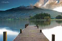 A Landing Stage on Ullswater  looking towards the Cumbrian Mountains, Lake District, Cumbria, England, Uk, Gb (PANDOOZY PHOTOS) Tags: uk greatbritain travel trees england lake mountains english tourism nature clouds walking landscape countryside sailing unitedkingdom stage jetty lakes tourist hike hills landing national cumbria fells mooring gb british moor tranquil attraction rambling pak waterscape ullswater aonb cumbrian ulswater