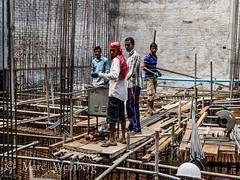 SAFETY, HARD HAT.....WHAT FOR? _C130919.jpg (Marc Weinberg) Tags: hardhat building male men architecture workers construction scaffolding steel labor safety flipflops maldives rebar multistory accidentprevention