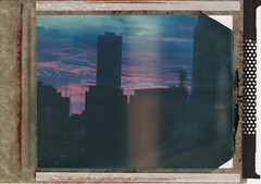 Twilight (DavidVonk) Tags: city sunset building tower film skyline clouds analog skyscraper vintage polaroid twilight instant 4x5 omaha expired largeformat woodmen graflex crowngraphic type59 t59