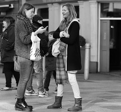 I bet you he doesn't answer! (Just Ard) Tags: street people blackandwhite bw white black blancoynegro monochrome face scarf person photography mono nikon women noiretblanc zwartwit candid 85mm d750 unposed  biancoenero communicating schwarzundweis justard