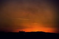The nearest exit may be behind you (Melissa Maples) Tags: sunset orange black silhouette turkey evening nikon asia sundown dusk trkiye nikkor chemtrail vr afs bursa  18200mm  f3556g  18200mmf3556g d5100