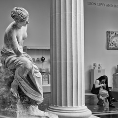 The Curious Muse (CVerwaal) Tags: nyc blackandwhite sculpture muse metropolitanmuseum cellphones ancientrome sonyrx100iii
