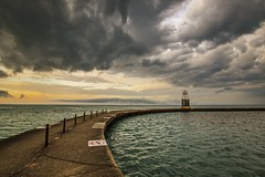 Evening at North Avenue Beach (Kevin Povenz) Tags: sunset sky sun chicago storm wet water rain weather clouds evening pier dusk cement stormy lakemichigan april stormyweather lookingeast 2016 illinios canon7dmarkii kevinpovenz