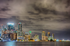 miami florida city skyline at night (DigiDreamGrafix.com) Tags: city bridge blue light sunset urban panorama usa cloud color reflection water skyline architecture night america skyscraper buildings landscape evening office twilight colorful downtown cityscape exterior waterfront view florida miami dusk famous landmark scene location panoramic reflect destination metropolis metropolitan