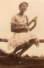 Vintage Snapshot : Josephine Gilchrest with Banjolele (CHAIN12) Tags: woman girl fence photo ukulele snapshot banjo scanned ukelele younglady banjulele unqsllr27josephinegilchrest