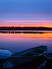 Boats (Antti Tassberg) Tags: sunset sun lake reflection beach silhouette espoo lens 50mm prime boat spring sundown shore serene vene ranta jrvi auringonlasku aurinko kevt pitkjrvi laaksolahti
