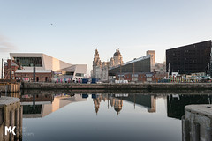 Resplendent in the sunshine (Michael Kirkham - Photographer) Tags: life uk light sea england reflection art architecture port liverpool docks sunrise photography spring liverbird thethreegraces liverbuildings