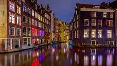 Amsterdam (adrianchandler.com) Tags: city nightphotography windows light red urban holland reflection building water netherlands dutch architecture night buildings river dark lights canal europe cityscape exterior nightscape terrace outdoor district calm structure nederlands waterway adrianchandler canon5dsr