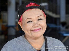 2016-01a Facing Exempt Langkawi (06) (Matt Hahnewald) Tags: facingtheworld asia southeastasia malaysia langkawi kuah smiling redhair cool baseballcap special emotion eyecontact hair character independent closedmouthsmile nikond3100 headshot ©matthahnewaldphotography ethnic oneperson malaysianchinesewoman 43aspectratio fabulous humanface nikkorafs50mmf18g humaneyes horizontalformat photography photo image lively outstanding fantastic favourite superior excellent inspirational vibrant breathtaking primelens portrait portraiture colour colourful personality realpeople human humanhead facialexpression posing authentic travel travelportrait adult female closeup street 50mmlens outdoor seveneighthsview