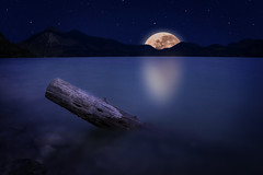 Moonrise-Lake (Chri Stall Klar) Tags: moon lake nature water night photoshop canon stars landscape see lowlight photographie sigma wideangle nighttime 1770 compositing langzeitbelichtung weitwinkel nightfromday photocollabo