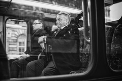 Business Class (Ross Magrath) Tags: street camera city winter portrait bw white man black streets cold colour bus wet face rain weather businessman contrast digital wonderful dark photography mono scotland weird high noir shadows gloomy serious no candid character sony north streetphotography cybershot business shade unknown worker gloom agus ban drama miserable et briefcase blanc sneaky dsc compact rx informal dubh rossmagrath