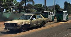 Car and Mototaxis (Alexander H.M. Cascone) Tags: road peru southamerica car drive automobile taxi moto vehicle tuktuk mala