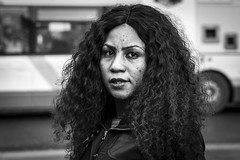 Curls (Leanne Boulton) Tags: life street city uk light shadow portrait people urban blackandwhite bw woman white black blur detail texture monochrome beauty face female canon hair 50mm mono scotland living blackwhite eyecontact natural humanity bokeh outdoor expression glasgow candid culture streetphotography curls scene depthoffield human shade portraiture 7d society tone facial imperfection candidportrait candidstreetphotography candideyecontact