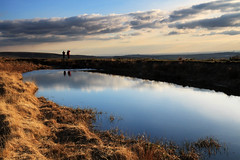 Towards The City (nigelhunter) Tags: city light england sky cloud lake reflection water mouth way landscape manchester evening pond couple cows lancashire trail walker national figure moor pennine quarry moorland toward
