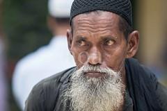 7D9_1017 (bandashing) Tags: street old portrait england people man face beard manchester sharif eyes shrine courtyard mad sylhet bangladesh beg mentalhealth socialdocumentary glazed mazar dargah aoa shahjalal glazedeyes bandashing akhtarowaisahmed