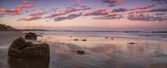 Sunset Colours (Stefan Nikoloff - Photography) Tags: blue sunset red sea orange seascape colour beach water clouds landscape seaside sand nikon rocks long exposure waves purple stones boulder hills d750 coastline waterscape 2470mm