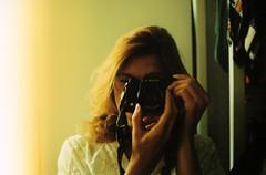 Self. (Leonor F) Tags: light summer woman sunlight film girl yellow analog self 50mm mirror daylight lomography autoportrait yashica