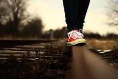Elginfield (Taylor William Jones) Tags: railroad red brown fall train rust shoes bright tracks rail converse