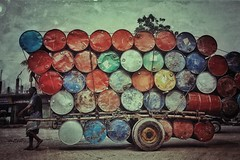 A laborer hauls barrels on a wooden cart in Dhaka, Bangladesh. Mohammad Kholilur Rahman, 49, has worked doing this job for the last 20 years. Everyday he carry's 45 barrel for a 14 kilometer distance by wooden cart. For every barrel he earn's 15 Taka (USD (auniket prantor) Tags: square squareformat iphoneography instagramapp uploaded:by=instagram