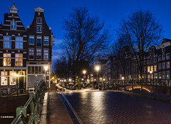 Amsterdam. (alamsterdam) Tags: longexposure people rain amsterdam reflections lights bridges bluehour takingpictures