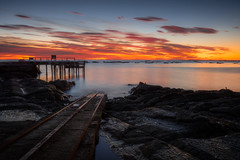 The Burning (Stefan Nikoloff - Photography) Tags: new blue red seascape yellow clouds sunrise coast pier boat seaside amazing interesting nikon rocks long exposure glow tide low boulders zealand wharf d750 coastline launch 2470mm kiakoura beauitful